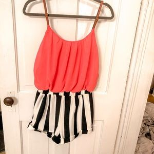 CORAL JUMPER WITH BLACK AND WHITE STRIPED SHORTS